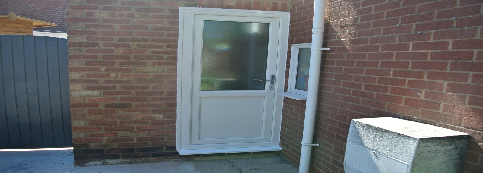 Half glazed back door with flat bottom panel
