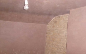 Plastering walls and ceiling